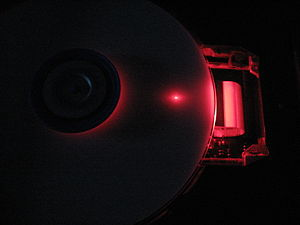 English: dvd burner operating with cover removed